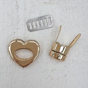 Hjärtformat väsklås, guld